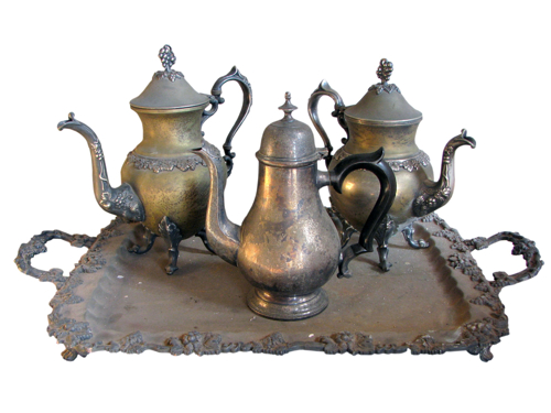 The history of tea - some old silver teapots on a tray